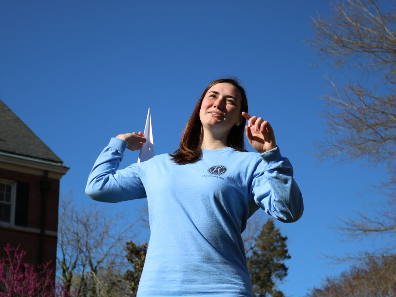 Sophomore Sara Lafontaine throws a paper airplane on Tuesday, March 26, 2019. The Residence Hall Association is hosting The Big Paper Airplane Tournament on Saturday, March 30, 2019 at 2 PM at the Connor Quad. The event is designed to raise awareness about sustainable practices. Free food and giveaways will be available to those who attend.