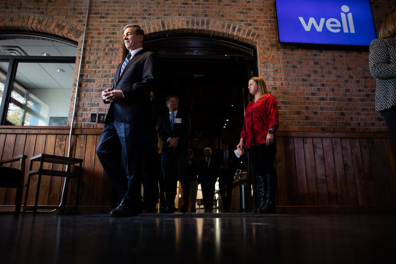 Gov. Roy Cooper enters the space at 419 W. Franklin St. ahead of a press conference introducing health technology company Well Dot Inc. to Chapel Hill on Tuesday, Nov. 19, 2019. Well plans to invest $3 million in Chapel Hill and Orange County.