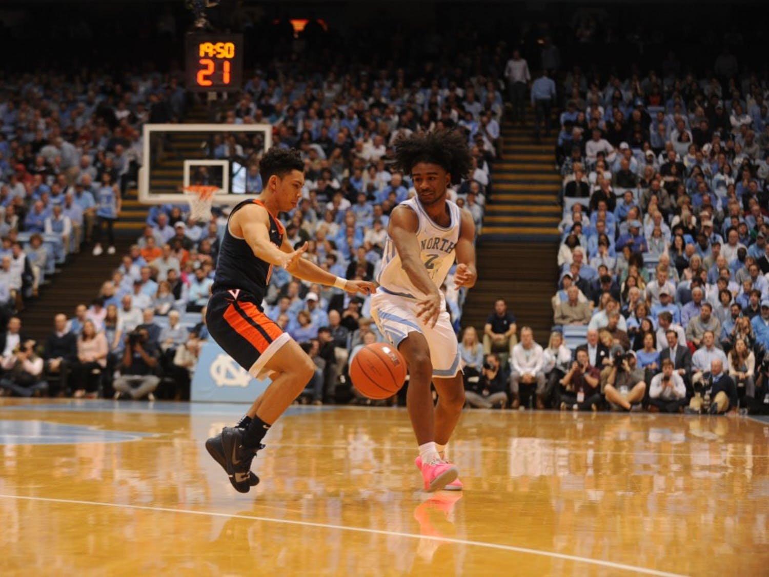 UNC first-year guard Coby White (2) drives past Virgina first-year guard Kihei Clark (0) on Monday, Feb. 11, 2019 in the Smith Center. White scored 17 points.