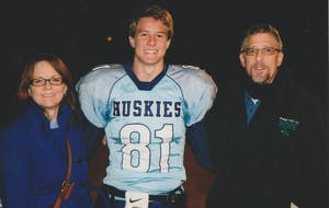 Current UNC men's basketball player Aaron Rohlman with his mother, Deborah, and his father, George, after a high school football game. Photo courtesy of the Rohlman family.