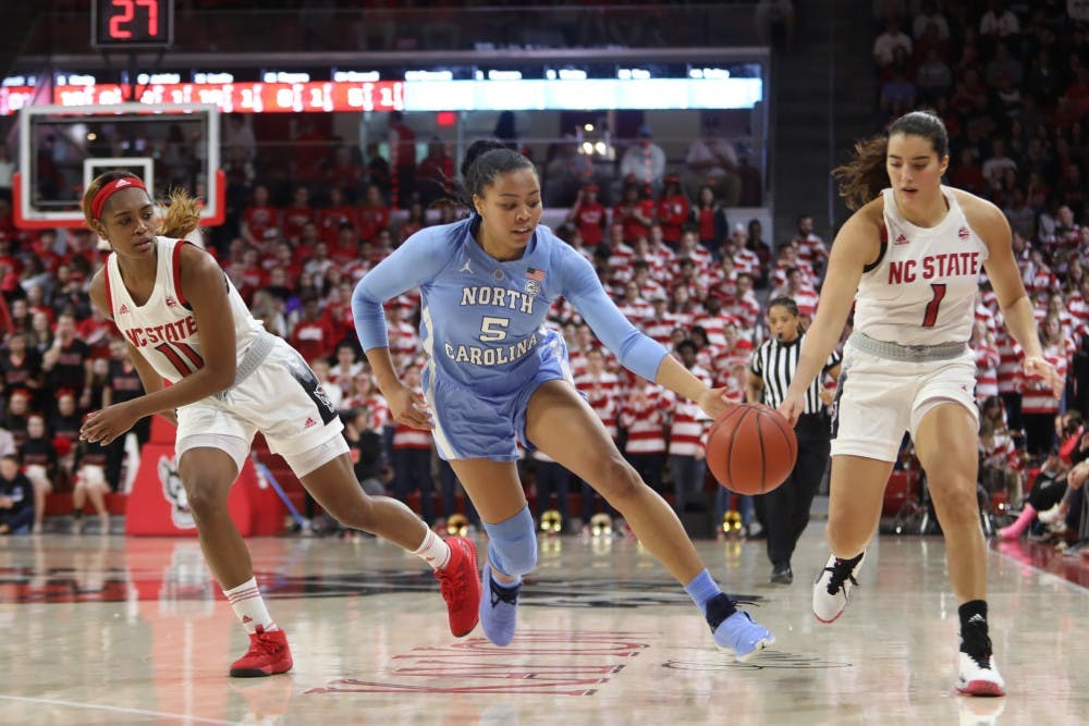 Tar Heel redshirt junior guard Stephanie Watts (5) steals the ball from Wolfpack junior guard Aislinn Konig (1) during UNC's 64-51 win against NC State at Reynolds Coliseum on Sunday, Feb. 3, 2019 in Raleigh, NC. The Tar Heels Women's Basketball Team (14-9) handed the Wolfpack (21-1) their first loss of the season.