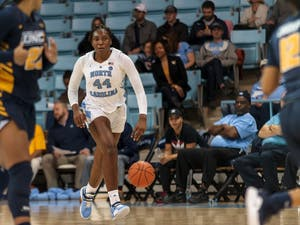 Center Janelle Bailey (UNC 44) dribbles the ball down the court during the UNC women's basketball home game vs. UNCG in Carmichael Arena on Friday, Dec. 14 2018.