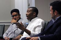 "Osiris Rankin, a senior psychology major, Darius Whitney, a senior political science major, and Dr. Juan Carrillo, an assistant professor in the UNC School of Education, discuss their place in the university setting and the challenges they have faced as minority males at a Carolina Millennial Scholars Program's event entitled ""The [Mis]sed Education of the Minority Male"" Thursday evening in Wilson Library."
