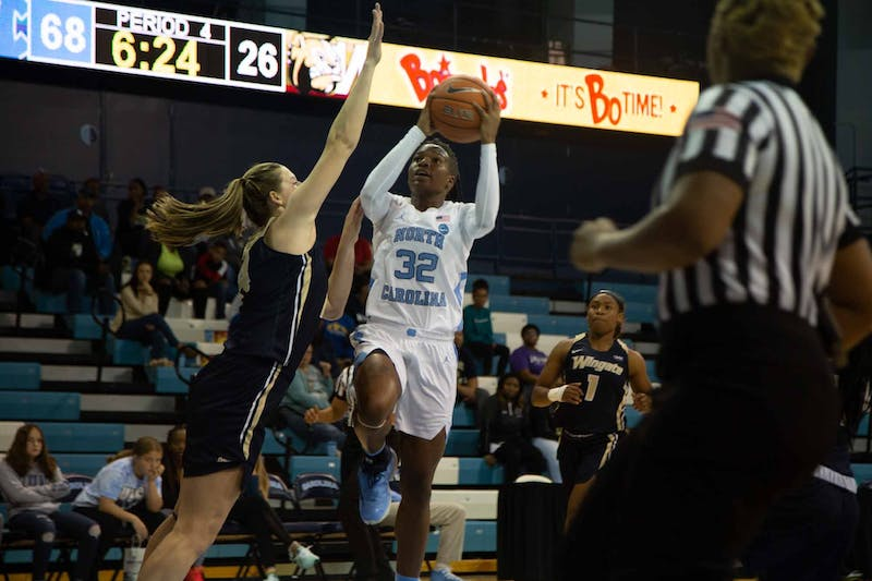 First-year guard Nia Daniel (32) shoots a free throw during exhibiton game against Wingate in the Charmichael Arena on Saturday, Nov. 2, 2019. UNC won 82-37.