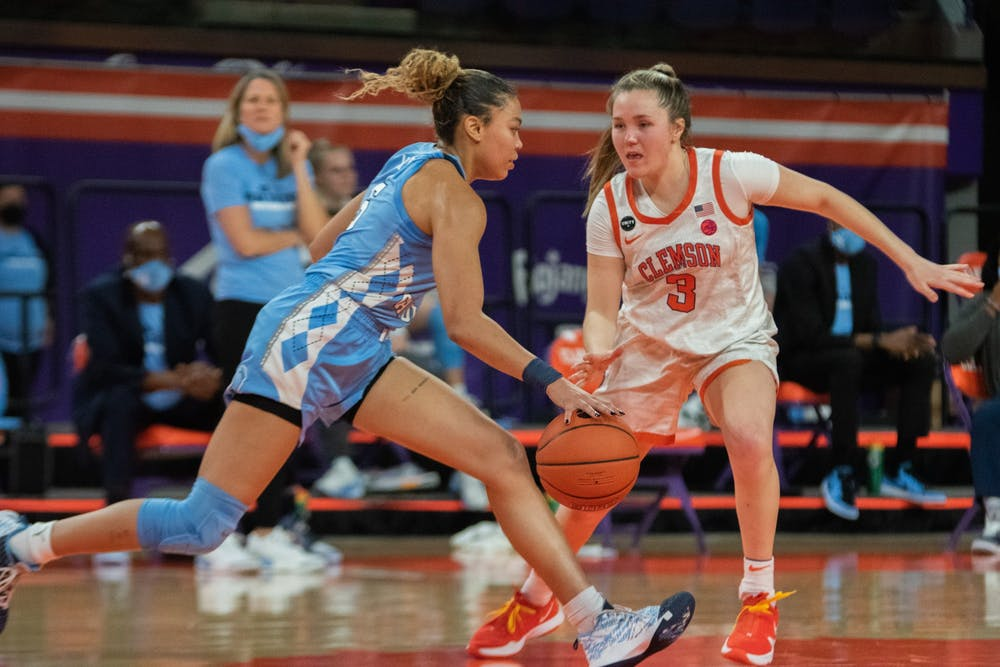 UNC graduate guard Stephanie Watts (5) dribbles downcourt during a game against Clemson on Feb. 18, 2021. UNC beat Clemson 77- 64. Photo courtesy of Caleb Browder.