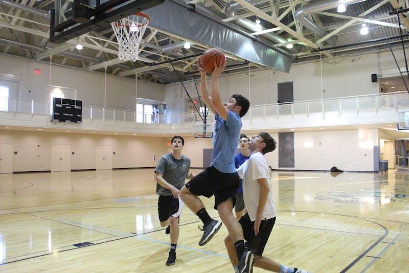 Ethan Dellamaestra takes a shot during a pick-up basketball game at at Ram's Head Recreation Center at the University of North Carolina at Chapel Hill on Jan. 9, 2019.