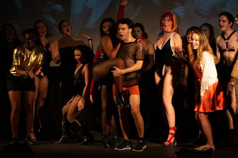 The cast of Pauper Players' 2019 production of Rocky Horror come on stage at the end of the show. Photo courtesy of Maria Cade.