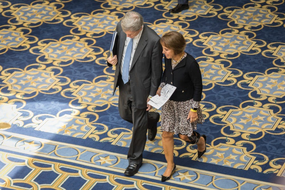 <p>UNC Chancellor Carol Folt walks with Mark Merritt, vice chancellor and general council of UNC, through the Gaylord Opryland Resort &amp; Convention Center in Nashville, Tenn. during a lunch break on Wednesday afternoon.</p>