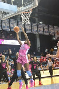 Freshman center Janelle Bailey (44) goes for a layup during Sunday's game against Louisville at Carmichael Arena.