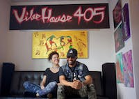 """Co-owners Wendy Mann and Kevin """"Kaze"""" Thomas sit in the gallery space at VibeHouse 405."""