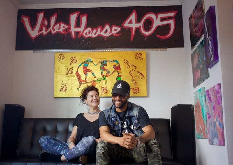 "Co-owners Wendy Mann and Kevin ""Kaze"" Thomas sit in the gallery space at VibeHouse 405."