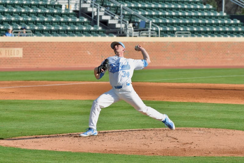 First-year Caden O'Brien (34) pitches against UNC-Wilmington on Feb. 20 at Boshamer Stadium.