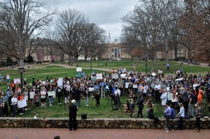 Students gather in front of Wilson Library to protest gun violence on Thursday morning.