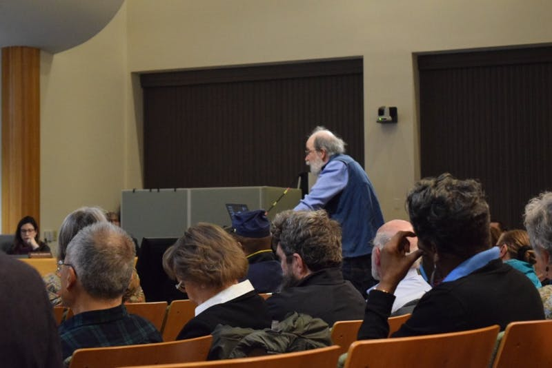 """Citizens of Chapel Hill gather to discuss the topic of the coal plant implementation in town and its effect on UNC. """"Don't let UNC drag it's feet,"""" coming from the words of John Wagner speaking on the issue at Chapel Hill's Town Hall on Wednesday, Feb. 9, 2019."""