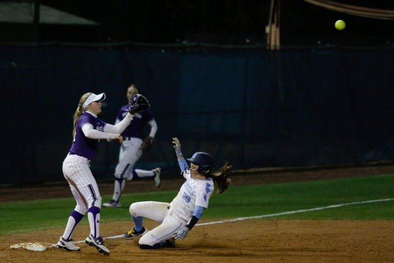 Abby Settlemyre (29) slides into third base at a game against Northwestern on Friday, Feb. 15, 2019 at Anderson Stadium.