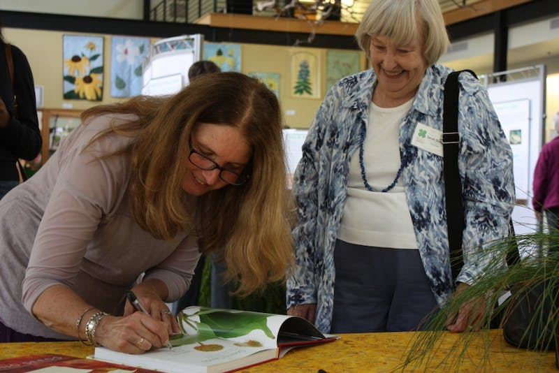 "Sarah Dendy of Durham has her copy of ""Seeing Seeds"" signed by Teri Dunn Chace."