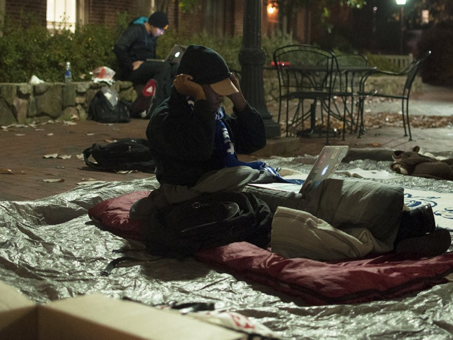 Frank Tillman, president of Phi Beta Sigma fraternity, sleep out for the homeless in the SASB Plaza taking donations for the homeless shelter on Franklin Street.