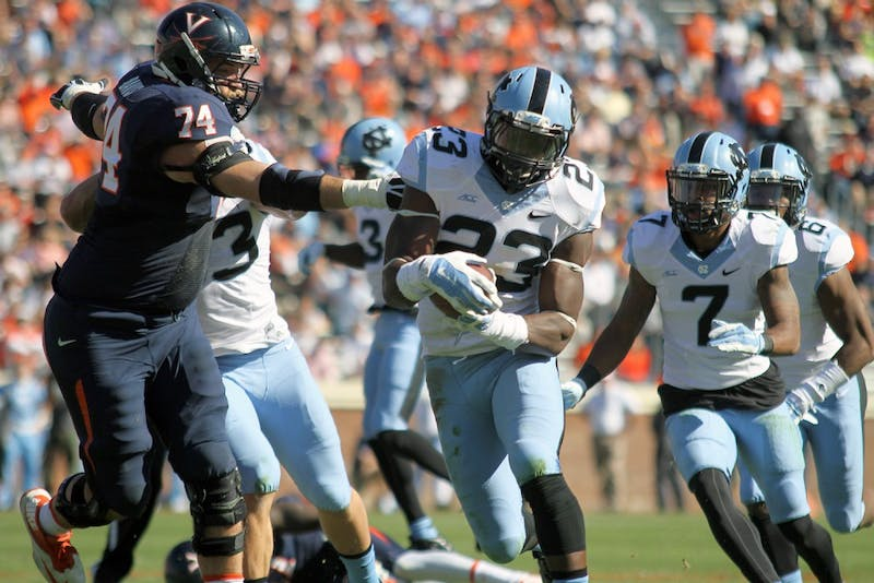 Cayson Collins runs the ball during the 2014 matchup against UVa.