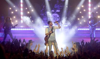 Former UNC student and performer Chase Rice performs as a part of the2016 Jubilee hosted by the Carolina Union Activities Board. Rice performed in Carmichael Arena after the Spring Game.