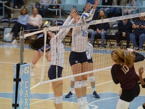 UNC volleyball redshirt sophomore Hunter Atherton (10) and first-year Ava Bell (20) block a spike from a FSU player during the game against the Seminoles on Wednesday, Nov. 21, 2018. UNC lost the game 3-0.