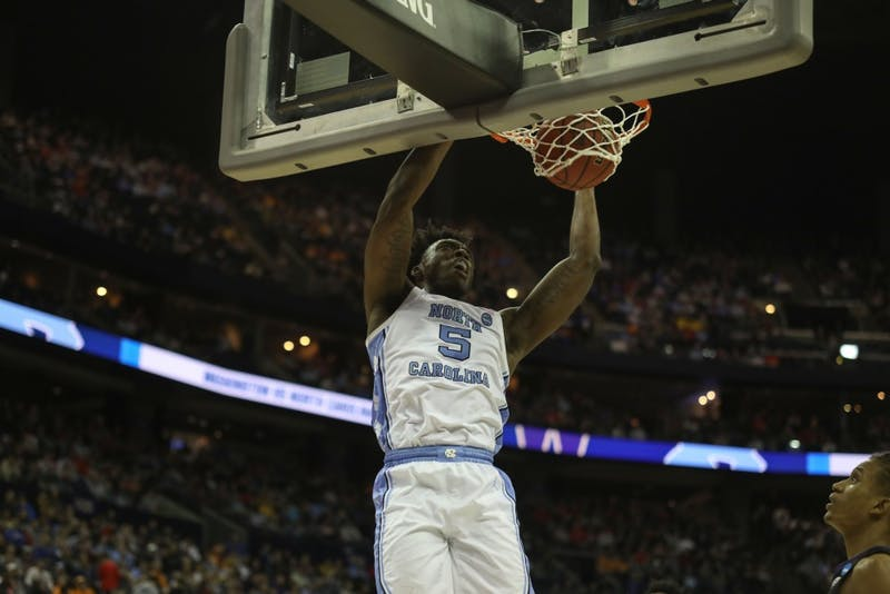 First-year guard Nassir Little (5) dunks against Washington in the second round of the NCAA tournament at Nationwide Arena in Columbus, OH on Sunday, March 24, 2019. UNC defeated Washington 81-59 to qualify for the Sweet 16.