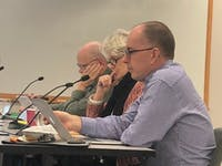 OWASA board members John Young, Jody Eimers and Bob Morgan discuss the water main break at the Nov. 8 meeting.