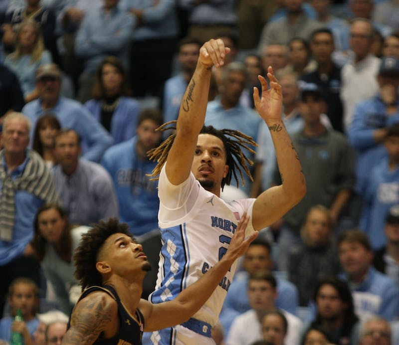 UNC guard Cole Anthony (2) shoots over Notre Dame's Prentiss Hubb (3) on Wednesday, Nov. 6, 2019 in the Dean E. Smith Center. Anthony finished the game with 34 points and 11 rebounds. The Tar Heels beat the Fighting Irish 76-65.