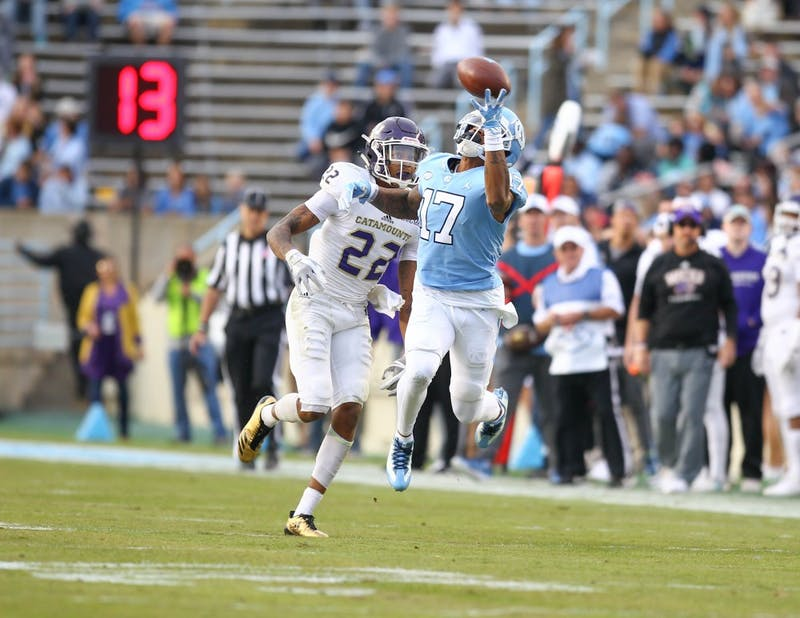 Wide receiver Anthony Ratliff-Williams (7) leaps for a catch against Western Carolina on Saturday in Kenan Stadium.