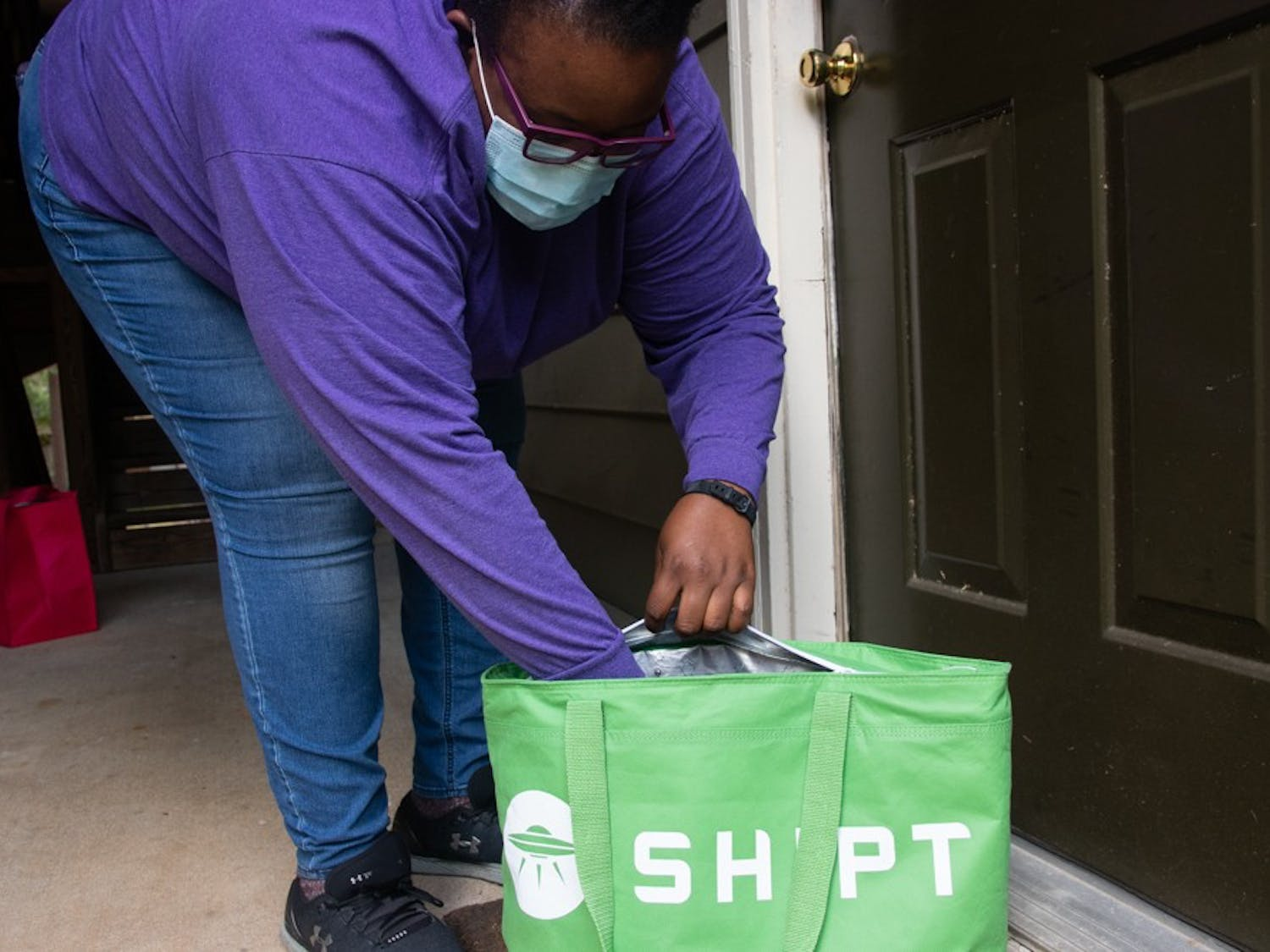 Delivery driver Daisy Otutuoloro prepares for a food delivery through Shipt in Raleigh, NC on Saturday, Aug. 29, 2020. Many unemployed workers in the Triangle have been turning to gig economy platforms such as these to supplement income lost due to the COVID-19 pandemic.