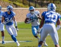 Antonio Williams (24) runs with the ball against Duke at Wallace Wade Stadium on Nov. 10, 2018.