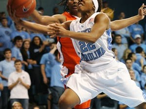 UNC point guard Cetera DeGraffenreid drives toward the basket in UNC's 79-61 win against Clemson on Friday. DTH/BJ Dworak