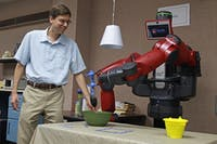 Professor Ron Alterovitz demonstrates the functions of one of the robots he and his students programmed.