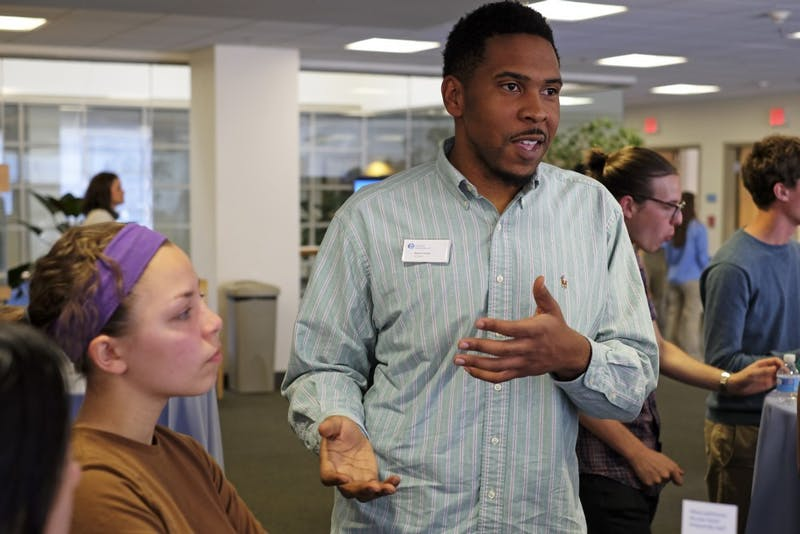 Keelon Dixon discusses with students at the Carolina Pulse event Tuesday evening.