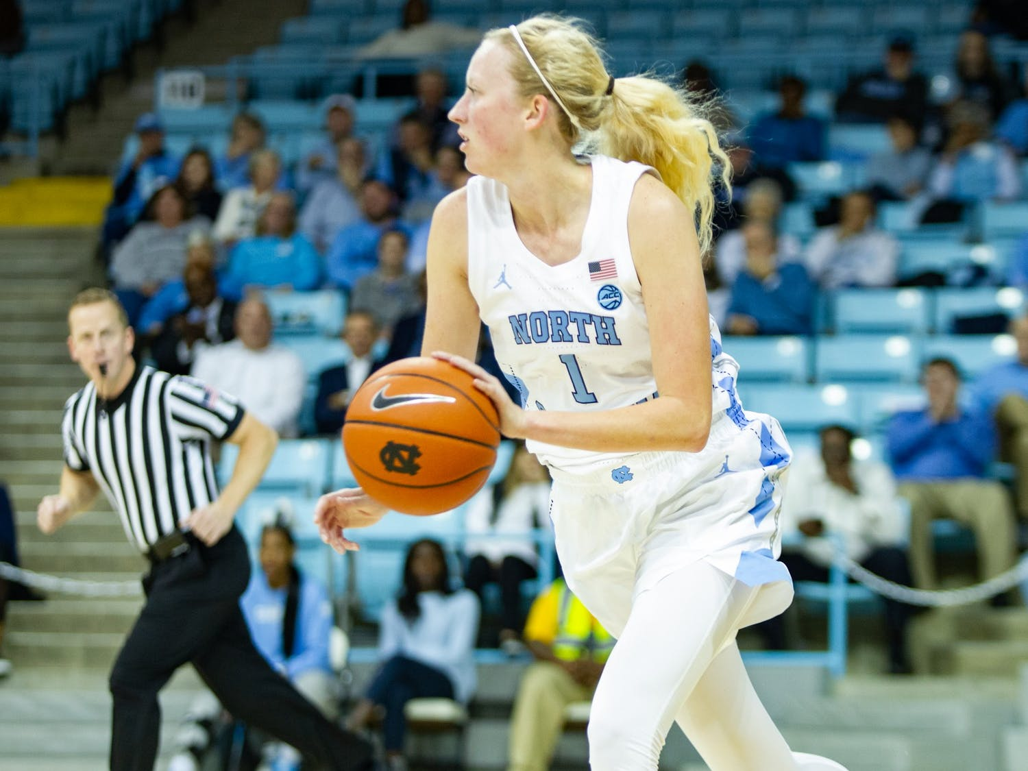 UNC's senior guard Taylor Koenen (1) dribbles the ball down the court during a game at Carmichael Arena on Monday, Nov. 11, 2019. UNC beat Navy 80-40.