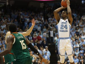 UNC senior guard Kenny Williams (24) shoots a three-pointer against Miami on Saturday, Feb. 9, 2019 in the Smith Center. UNC men's basketball defeated Miami 88-85 in overtime.