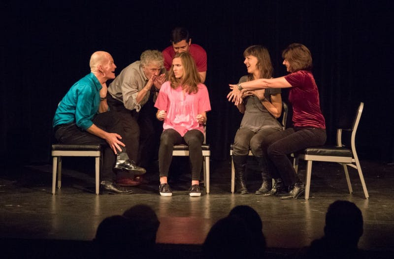 Members of Transactors Improv Company performing during an improv show. (From left, Greg Hohn, Steve Scott, Bart Hubbard, Juliet Kaplan, Jane Allen Wilson, Anoo Tree Brod.) Photo courtesy of Sara Woodmansee.