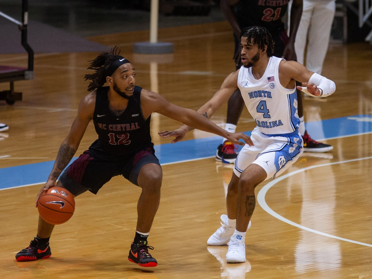 UNC's first year guard RJ Davis (4) defends against N.C. Central's senior guard Jordan Perkins (12) during a game in the Smith Center on Saturday, Dec. 12, 2020. UNC beat N.C. Central 73-67.