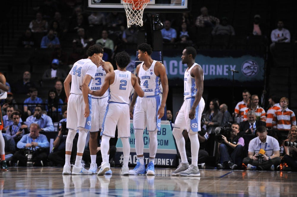 <p>The Tar Heels huddle between play during the game against Miami on Thursday. UNC is the No. 1 seed in the South region for the NCAA tournament.&nbsp;</p>