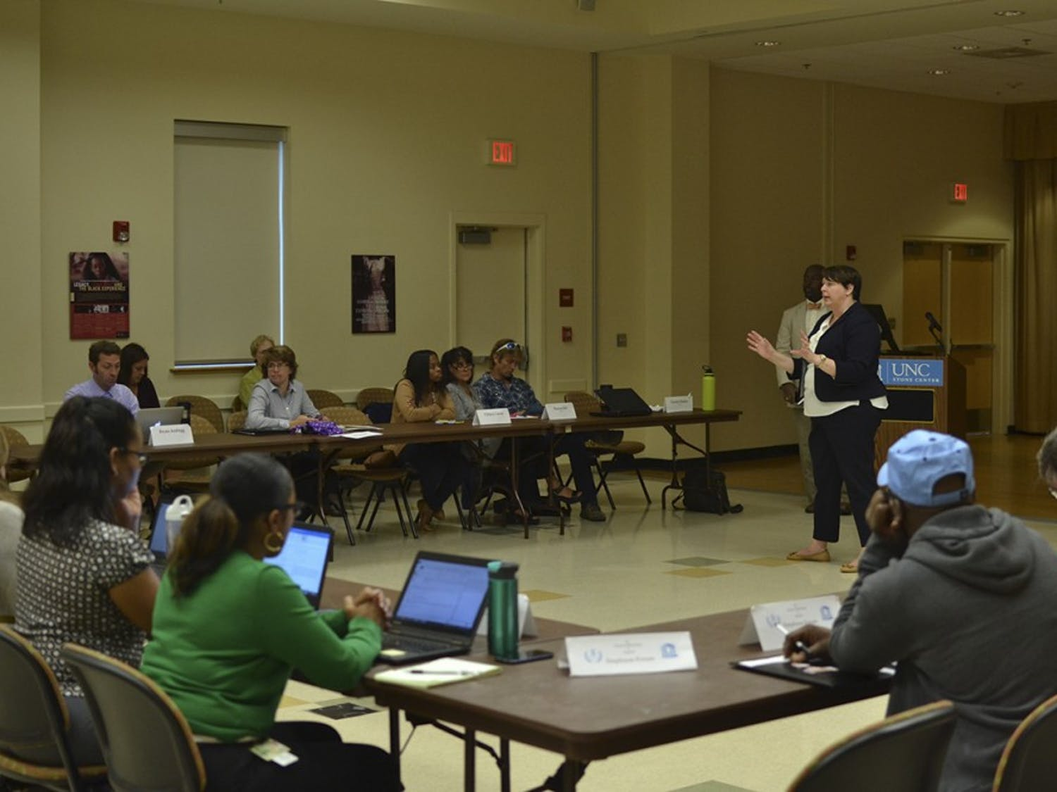 Michele Gretch Carter, newly appointed manager of the Student Stores, discusses her role on campus at an Employee Forum meeting at the Stone Center.