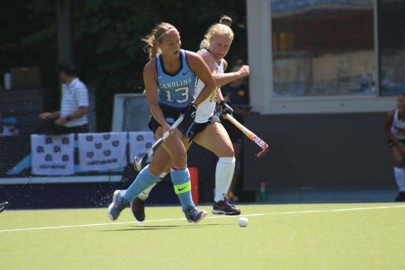 Senior defender Ashley Hoffman (13) boxes out a defender during UNC's 2-1 win over Iowa at Carolina Field Hockey Stadium on Aug. 26.