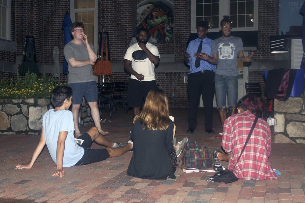 <p>Students participate in a freestyle hip-hop cypher on Wednesday night.</p>