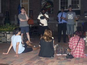 Students participate in a freestyle hip-hop cypher on Wednesday night.