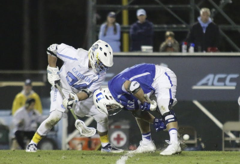 Senior Midfielder Stephen Kelley (24) faces off against Duke at the game on Sunday.