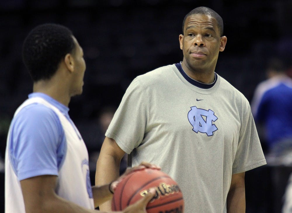 Assistant coach Hubert Davis raises his eyebrows at Nate Britt during practice. The UNC men's basketball team held an open practice at the AT&T Center in San Antonio on Thursday. The Tar Heels will face Providence in the second round of the NCAA tournament on Friday.