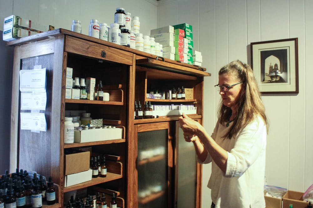 <p>Dr. Susan DeLaney, 66, of Chapel Hill, working in her office on Saturday, Oct. 5, 2019 at The Wellness Alliance in Carrboro. DeLaney is a naturopathic general practitioner and uses natural medicines to treat various ailments.</p>