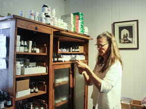 Dr. Susan DeLaney, 66, of Chapel Hill, working in her office on Saturday, Oct. 5, 2019 at The Wellness Alliance in Carrboro. DeLaney is a naturopathic general practitioner and uses natural medicines to treat various ailments.
