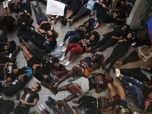 Students staged a die-in in the Student Union today in response to the demonstrations going on in Charlotte.
