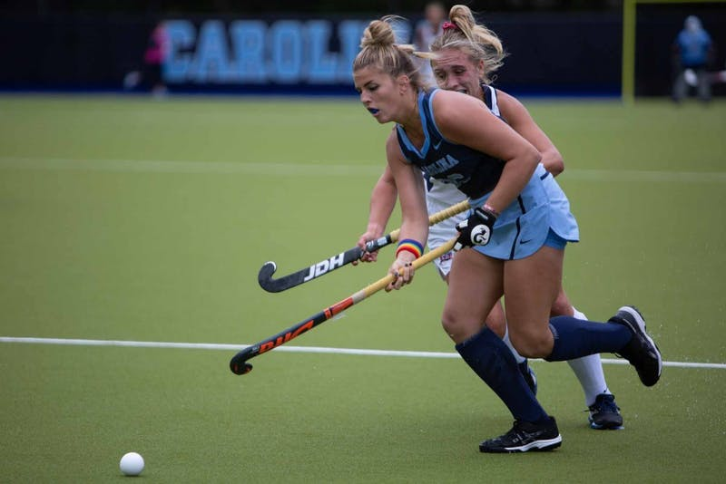 UNC's sophomore forward Riley Fulmer (26) defends the ball against Liberty University senior defender Annika Roberts (4) on Sunday, Oct. 20, 2019 in Karen Shelton Stadium. The Tar Heels won 3-2 against the Liberty Flames.