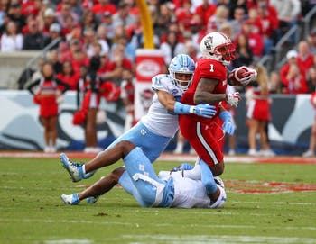 North Carolina safety Myles Wolfolk (11) tackles N.C. State all-purpose back Jaylen Samuels (1) on Nov. 25 in Raleigh,