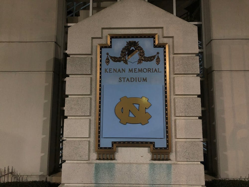 Plaque with racist ties at Kenan Stadium covered by UNC logo